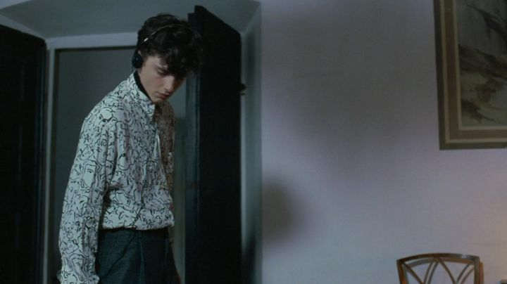 The shirt printed faces by Podartist of Elio Perlman (Timothée Chalamet) in Call Me by Your Name - Movie Outfits and Products