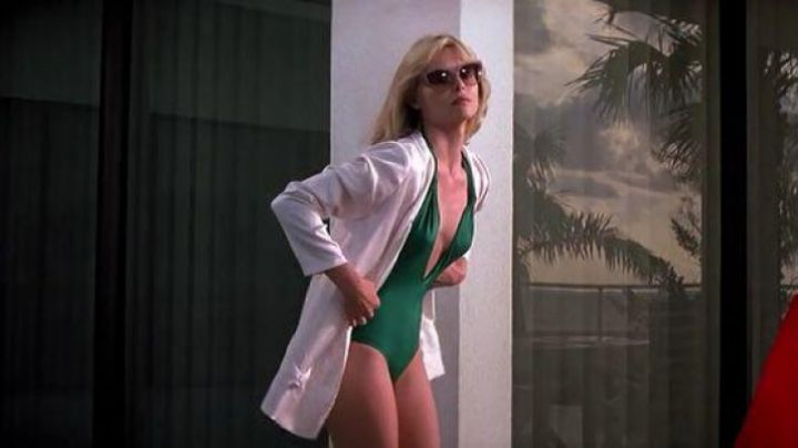 Fashion Trends 2021: The swimsuit is green and plunging Elvira Hancock (Michelle Pfeiffer) in Scarface