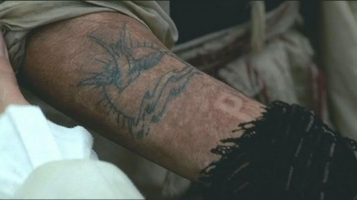 The tattoo of Jack Sparrow (Johnny Depp) in Pirates of the Caribbean The curse of the Black Pearl - Movie Outfits and Products