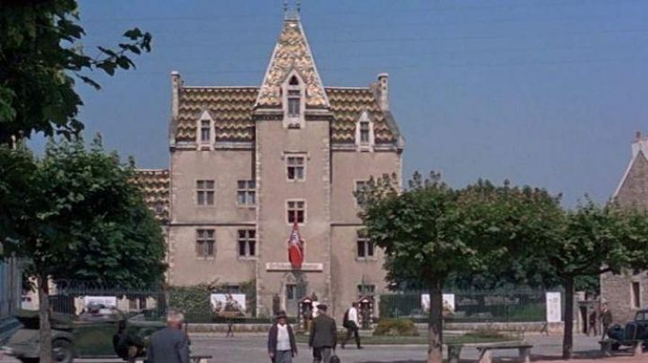 The town hall of Meursault acting as a Command in The Grande Vadrouille - Movie Outfits and Products