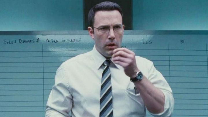 The watch with black strap of Christian Wolff (Ben Affleck) in Mr Wolff movie