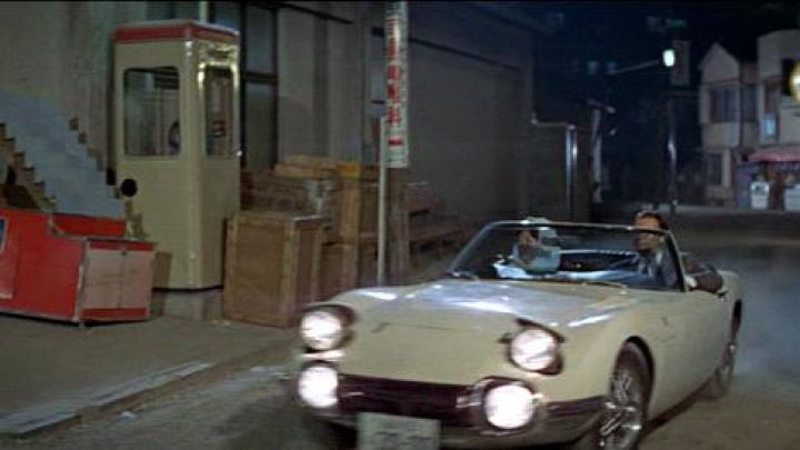 Toyota 2000 GT convertible in white driven by Aki (Akiko Wakabayashi) as seen in You Only Live Twice - Movie Outfits and Products