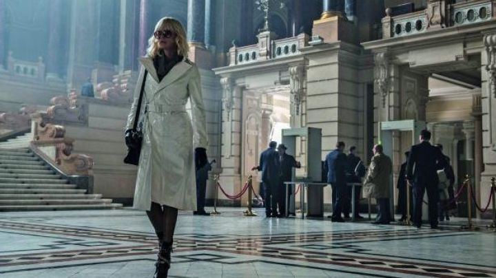 White Trench Coat worn by Lorraine Broughton (CharlizeTheron) as seen in Atomic Blonde - Movie Outfits and Products