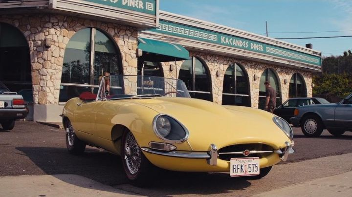 Yellow Jaguar E-Type driven by Jordan Belfort (Leonardo DiCaprio) as seen in The Wolf Of Wall Street - Movie Outfits and Products