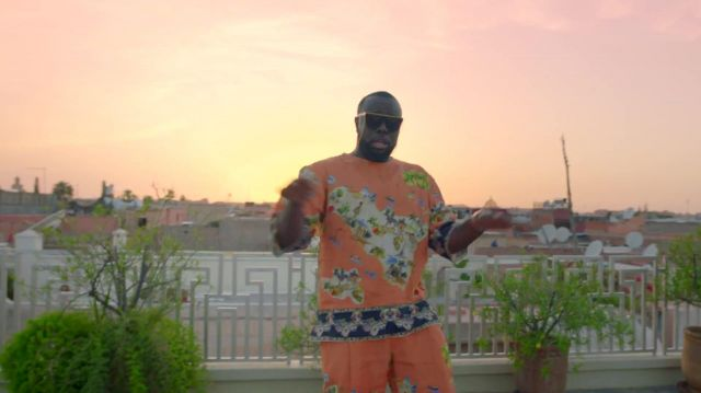 All orange pattern sicilia outfit worn by maître gims maître gims in the clip GIMS, Maluma - Hola Señorita (Maria) [Official Video] - Youtube Outfits and Products