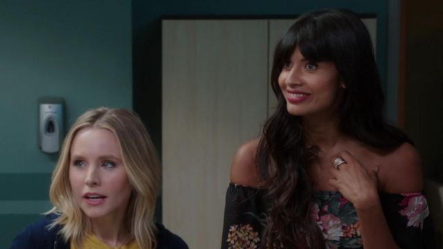 Black dress flowered one of Ms. Al-Jamil (Jameela Jamil) seen in The Good Place (Season 3 Episode 1) - TV Show Outfits and Products