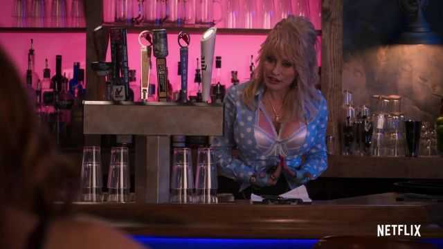 Blue shirt with white polka dot outfit worn by Babe (Dolly Parton) in Dolly Parton's Heartstrings (S01) - TV Show Outfits and Products