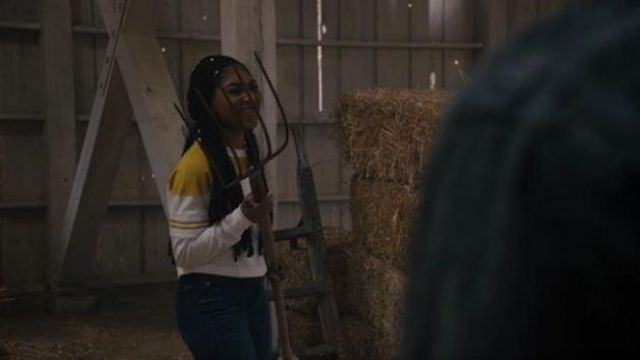Champion UO Yellow Striped sleeve baseball Tee outfit worn by Peri Boudreaux (Adriyan Rae) in Light as a Feather Season 02 Episode 15 - TV Show Outfits and Products