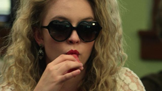 Fashion Trends 2021: Pair of glasses in the shape of hearts black Emaline d'addario (Sydney Sweeney) seen in Everything Sucks Season 1 Episode 2