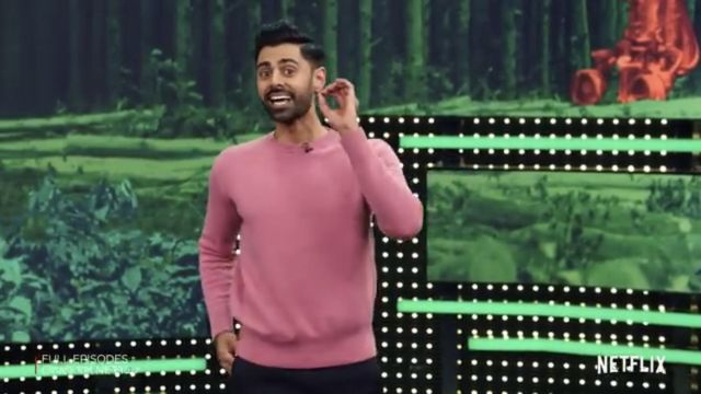 Pink sweater outfit worn by Hasan Minhaj as seen in Patriot Act with Hasan Minhaj S02E01 - TV Show Outfits and Products