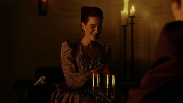 Purple dress of Ms. Wilhemina Venable (Sarah Paulson) seen in American Horror Story Revelation (Season 8) - TV Show Outfits and Products