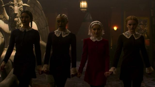 Red dress with peter pan collar in lace outfit worn by Sabrina Spellman (Kiernan Shipka) seen in The New Adventures of Sabrina Season 1E10 - TV Show Outfits and Products