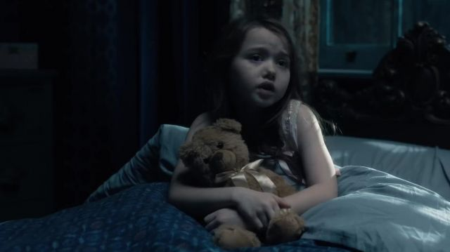"""Teddy bear of the young Nell (Violet McGraw) seen in """" The Haunting of Hill House (Season 1) - TV Show Outfits and Products"""