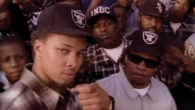 The black hat of the Raiders outfit worn by Eazy-E in her video clip Real Muthaphuckkin G's (Dirty) - Youtube Outfits and Products
