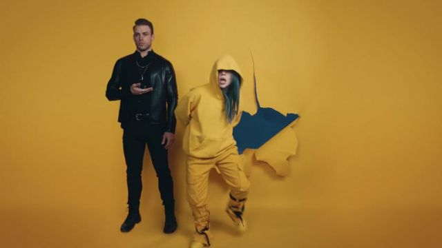 The pants yellow Reserved outfit worn by Billie Eilish in her video clip Bad Guy - Youtube Outfits and Products