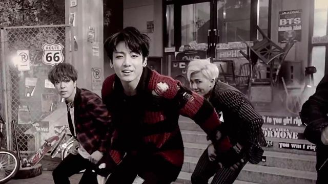 The sweater striped red and black Jungkook in the clip, War of Hormone BTS - Youtube Outfits and Products