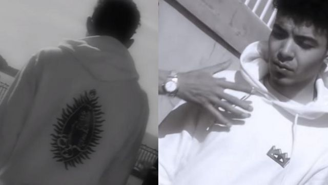 "The sweatshirt is white with a crown logo of Zamdane in her music video ""When I smoke"""