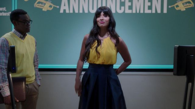 Top yellow Michael Kors outfit worn by Ms. Al-Jamil (Jameela Jamil) seen in The Good Place Season 3 Episode 3 - TV Show Outfits and Products
