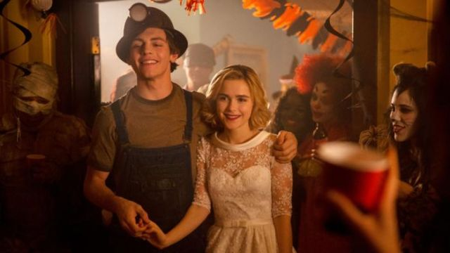 White wedding dress of Sabrina Spellman (Kiernan Shipka) seen in The New Adventures of Sabrina Season 1 Episode 2 - TV Show Outfits and Products