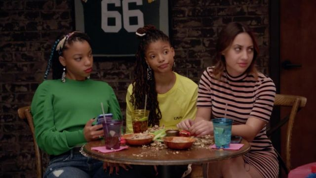 """Fashion Trends 2021: Yellow t-shirt """"Caos"""" Hyein Seo Skylar Forster (Halle Bailey) seen in Grown-ish Season 1 Episode 5"""